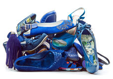 Pile of female blue shoes. Isolated on white background stock photos