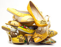 Pile of female yellow shoes Stock Photo