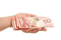 Pile Of Fifties. Isolated on white hand holding Canadian money Stock Images