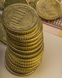 Pile of fifty euro cents lie on a paper bill of fifty euros. Euro money.  Currency of the European Union Stock Photo