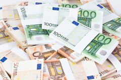 Pile of fifty and one hundred euro banknotes. On white background Stock Photography