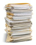 Pile of files in folders isolated on white. Pile folders files table yellow large white Royalty Free Stock Photo