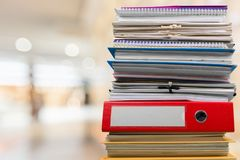 Pile of files in folders on table on blurred. Pile folders files table yellow large white Royalty Free Stock Images