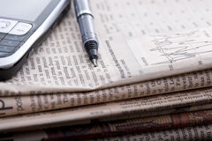 Pile of financial newspapers Stock Photography