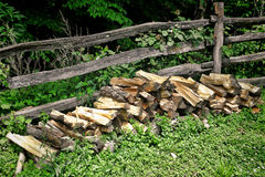 Pile of Fire Wood Split Logs and Old Rail Fence Royalty Free Stock Images