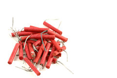 Pile of firecrackers. A pile of red firecrackers isolated on white space with room for text Stock Images