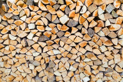 Pile of firewood as tree trunks Royalty Free Stock Photo