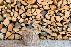 Pile of firewood with axe Royalty Free Stock Image
