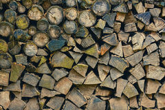 Pile of firewood. Background of dry chopped firewood logs in a pile Stock Image