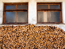 Pile of firewood in front of a house Royalty Free Stock Photos