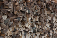 Pile of firewood fuel wood fills the whole frame. Pile of firewood fuel wood woodpile fills the whole frame framed with angle Royalty Free Stock Images