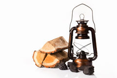 Pile of firewood and oil lamp Royalty Free Stock Photos