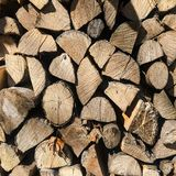 Pile of firewood. Stack of chopped tree logs nature background texture. Firewood stacked. Chipped organic firewood Royalty Free Stock Images