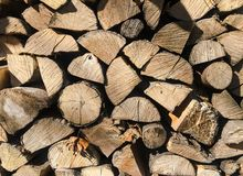 Pile of firewood. Stack of chopped tree logs nature background texture. Firewood stacked. Chipped organic firewood. Organic Backgr Stock Image