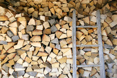 Pile of firewood store in shed Royalty Free Stock Photos