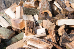 Pile of firewood waiting to be stacked Royalty Free Stock Photo