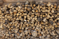 A pile of firewood at the wall of the wooden house Royalty Free Stock Images
