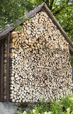 Pile of firewood at a wooden house wall Stock Photo