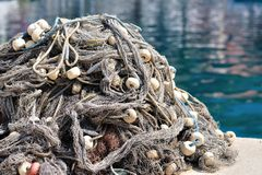 Pile of fishing nets with floats on a quay Royalty Free Stock Images