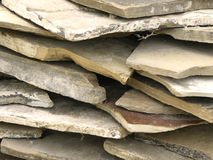 Pile of flagstones. Natural irregular stone slabs for use in landscaping gardens Stock Image