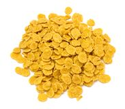 Pile of flakes. Cornflakes isolated on white background stock images