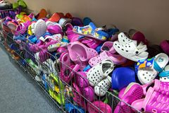 Pile of flip flops and sandals in the store. stock images