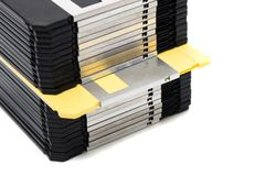 Pile of floppy disks. Vertical pile of computer floppy disks isolated on a white background Stock Photos