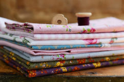 Pile of floral pattern textile in shabby style Stock Image