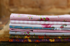 Pile of floral pattern textile in shabby style Stock Photos