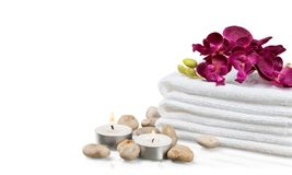 Pile of  fluffy towels with zen stones on white Royalty Free Stock Photo
