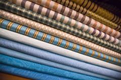 Pile of folded blue and striped fabric Stock Photography