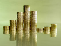 Pile folded of coins in the form of charts. Diagram consisting of piles of coins, denotes the growth and decline Stock Photos