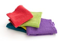 Pile of folded colorful kitchen towels, on white. Pile of  folded colorful kitchen towels, on white background Royalty Free Stock Image