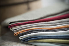 Pile of Folded Cotton Fabric on Wooden Surface Stock Images