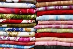 Pile of folded fabrics and shawls royalty free stock images