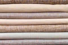 Pile of folded textile Stock Photos