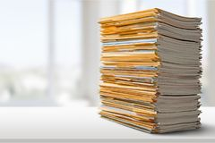 Pile of files in folders on light background. Pile folders files table yellow large white Royalty Free Stock Photography