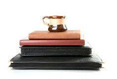 Pile of folders and organizers with a coffee cup Royalty Free Stock Photos