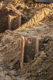 Pile foundation. Detail of some massive steel joists hammered in the ground to build a pile foundation Stock Images