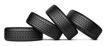 Pile of four black wheel tyres for car. On white background 3d image Royalty Free Stock Images