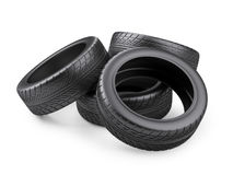 Pile of four new black tyres for car.  on white backgrou. Nd 3d image. 3d image. Isolated white background Stock Photos