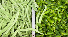 Pile of french beans and jalapeno peppers royalty free stock photos