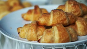 Pile of french croissants serving on plate stock footage