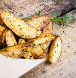 A pile of French fries with herbs and spices  in recycled craft Royalty Free Stock Photo