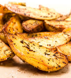 A pile of french fries potato wedges country styled. Fast food. Royalty Free Stock Photos