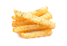 A pile of french fries on a white background, potato fry on whit. A pile of appetizing french fries on a white background stock photo