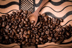 Pile of fresh and bio aromatic coffee beans and spoon Royalty Free Stock Photo