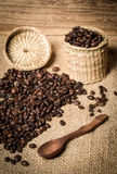 Pile of fresh and bio aromatic coffee beans and spoon and jar Stock Photography