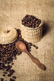 Pile of fresh and bio aromatic coffee beans and spoon and jar Royalty Free Stock Image