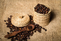 Pile of fresh and bio aromatic coffee beans and spoon and jar Royalty Free Stock Images